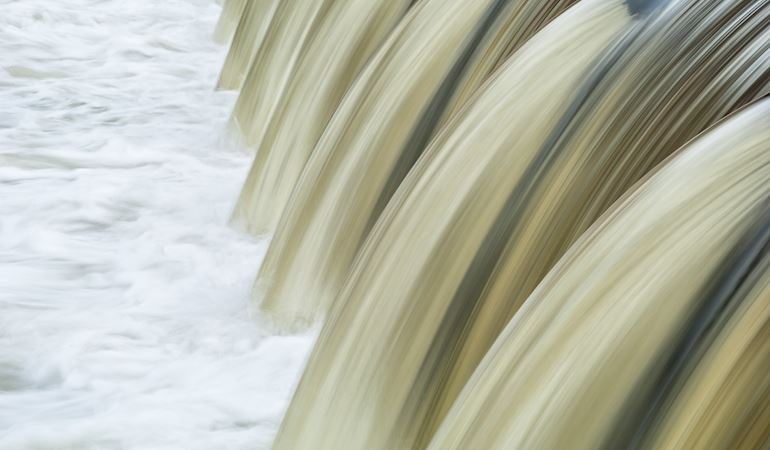 Water flowing over a weir