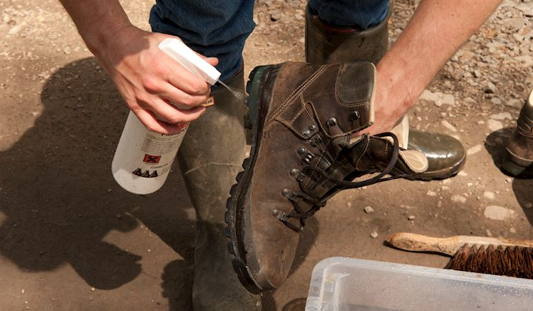 Man cleaning his boots
