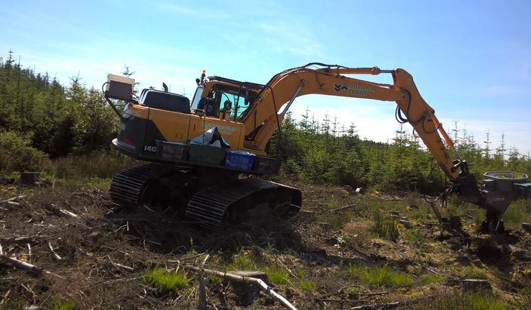 NRW using a mechanical planter Clocaenog and Tywi Forests