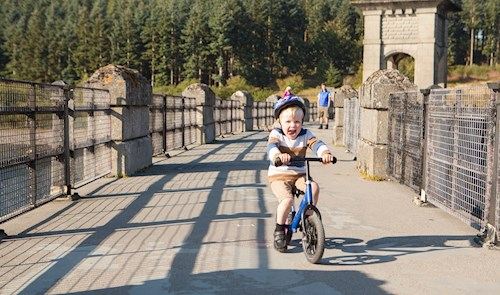 Child on bike at Alwen Reservoir