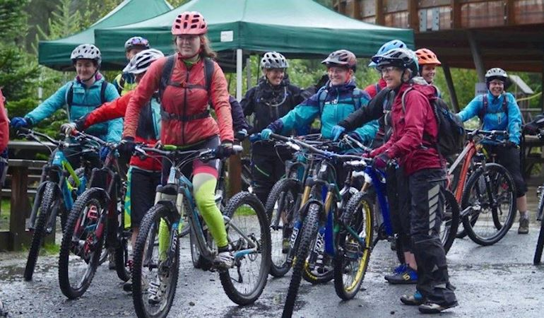 A group of women with mountain bikes
