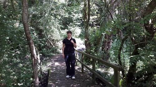 Woman walking in Llynfi woodland