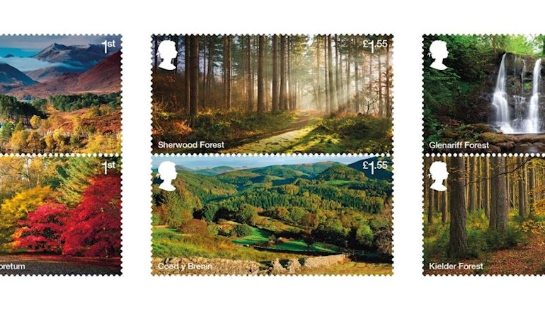 An image of six stamps, each with a photo of a different forests across the UK