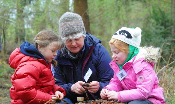 Woman teaching two girls