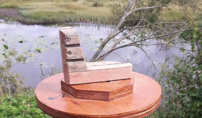 Picture Post on Cors Caron National Nature Reserve. You can place your camera or phone in the wooden frame and take a picture of the landscape.