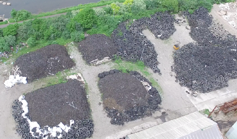 An aerial image of piles of waste tyres