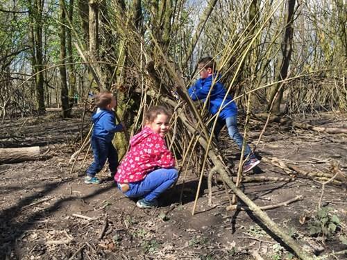 children building a bivouac outdoors