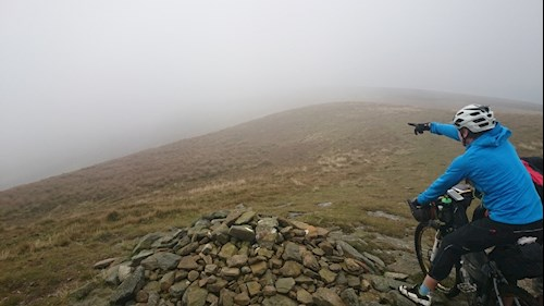 Mountain bikers navigating through fog