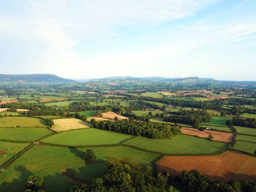 Ariel view of central Monmouthshire landscape, looking towards the Brecon Beacons