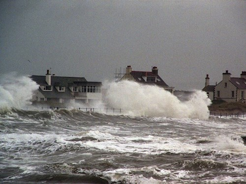 Houses by the coastline during a storm at Trearddur Bay, Anglesey