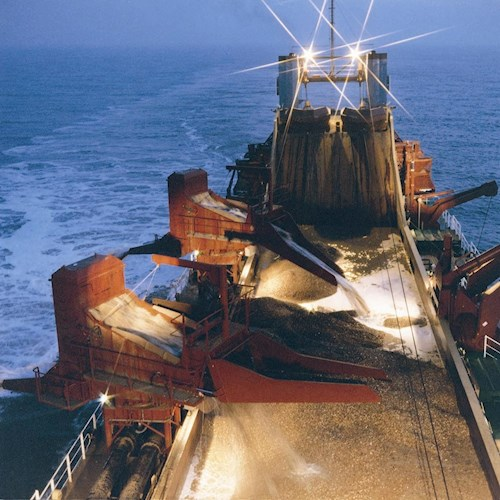 A Purpose Built Marine Aggregate Dredging Ship Operating In Welsh Waters At Night.