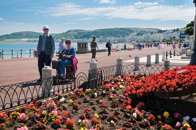 People walking along the promenade Llandudno