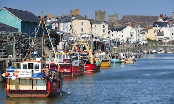 Fishing boats at Aberystwyth harbour with the town in the background