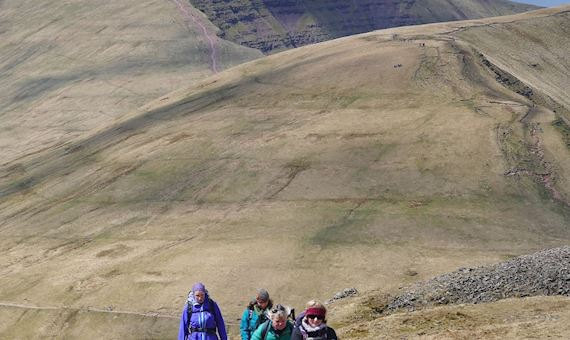 Hikers walking on Brecon Beacons