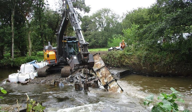 A crane lifts out the weir at Vicar's Mill on the Eastern Cleddau.