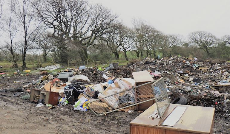 A pile of waste illegally deposited on land in Felinfoel, Llanelli