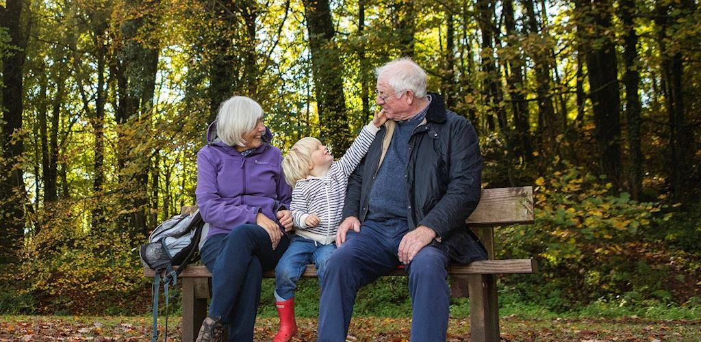 Family on bench in woodland