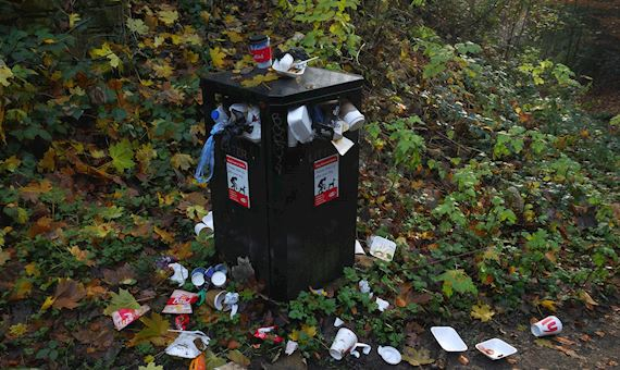 A bin overflowing with litter