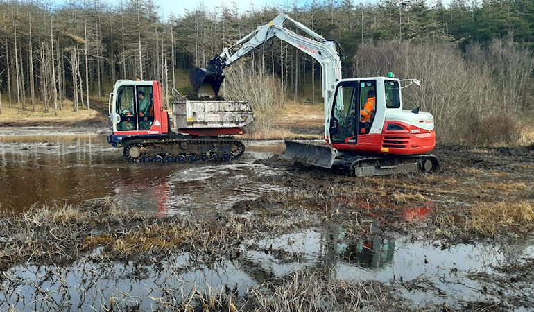 Diggers working on site at Newborough