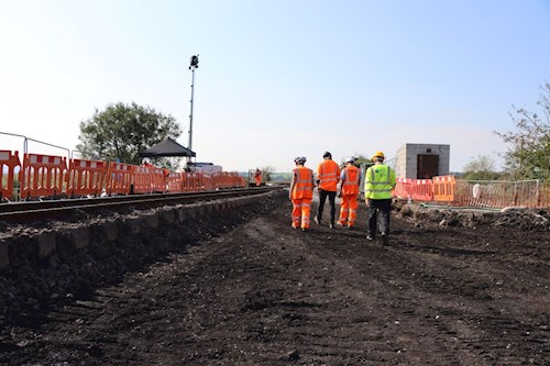 Four workers walking on site